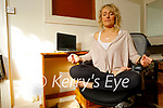 Meave Ferris relaxing at home in Ardfert doing her Online Chair Yoga.