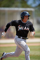 Miami Marlins catcher Roy Morales (45) runs to first base during a minor league Spring Training game against the New York Mets on March 26, 2017 at the Roger Dean Stadium Complex in Jupiter, Florida.  (Mike Janes/Four Seam Images)