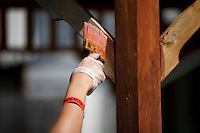 """A member applies wood stain to a gazebo during """"Circle the City with Service,"""" the Kiwanis Circle K International's 2015 Large Scale Service Project, on Wednesday, June 24, 2015, in Indianapolis. (Photo by James Brosher)"""