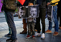 "Pictured: A young boy joins adult Kurdish protesters with a ""Dictator Erdogan"" banner gather at Syntagma Square in Athens Greece. <br /> Re: Kurdish people with protest against the Turkey president  Recep Tayyip Erdogan's visit to Greece. Thursday 07 December 2017"
