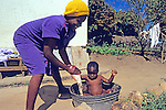 Woman Gives Toddler A Bath