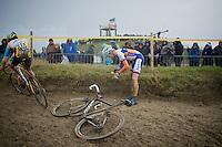 Gert-Jan Bosman (NLD) recuperating his glasses after a crash<br /> <br /> 2014 Noordzeecross