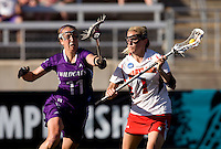 Sarah Mollison (1) of Maryland tries to get past Alexandra Frank (11) of Northwestern during the NCAA Championship held in Johnny Unitas Stadium at Towson University in Towson, MD.  Maryland defeated Northwestern, 13-11, to win the title.