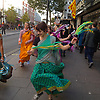 Hare Krishna Dancers in Oxford Street in Central London, followed by their drummers.<br />