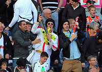 FAO SPORTS PICTURE DESK<br /> Pictured: Swansea supporters dressed in Elvis Pressley costumes celebrating their team's goal. Sunday, 13 May 2012<br /> Re: Premier League football, Swansea City FC v Liverpool FC at the Liberty Stadium, south Wales.