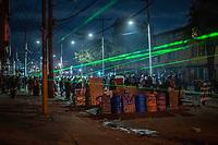 BOGOTA - COLOMBIA, 25-05-2021: Miembros de la primera línea montan guardia para defenderse del accionar del ESMAD (Escuadrón Móvil Antidisturbios de la Policía) durante los disturbios en el sector de las Américas de la ciudad de Bogotá durante el día 28 del Paro Nacional en Colombia hoy, 25 de mayo de 2021, para protestar contra el gobierno de Ivan Duque además de la precaria situación social y económica que vive Colombia. El paro fue convocado por sindicatos, organizaciones sociales, estudiantes y la oposición. / Members of the front line stand guard to defend themselves from the actions of the ESMAD (Police Anti-Riot Mobile Squad)  during the riots at Portal Las Americas sector of the city of Bogota during the day 28 of the National strike in Colombia today, May 25, 2021, to protest against the government of Ivan Duque in addition to the precarious social and economic situation that Colombia is experiencing. The strike was called by unions, social organizations, students and the opposition in Colombia. Photo: VizzorImage / Diego Cuevas / Cont