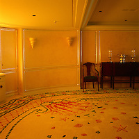 A sea themed carpet with shells, starfish and coral covers the floor of the dining room