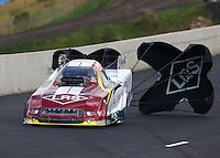 Jul. 19, 2014; Morrison, CO, USA; NHRA funny car driver Tim Wilkerson during qualifying for the Mile High Nationals at Bandimere Speedway. Mandatory Credit: Mark J. Rebilas-