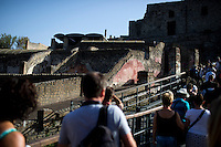 Tourists make their way into the ruins on Friday, Sept. 18, 2015, in Pompeii, Italy. The city of Pompeii was destroyed when nearby Mount Vesuvius erupted on August 24, AD 79. The town and its residents were buried and forgotten until the ruins were discovered and eventually excavated hundreds of years later. The ruins are one of Italy's top tourist attractions today. (Photo by James Brosher)