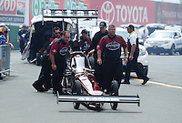 Jul. 31, 2011; Sonoma, CA, USA; NHRA top fuel dragster crew members for driver Larry Dixon during the Fram Autolite Nationals at Infineon Raceway. Mandatory Credit: Mark J. Rebilas-