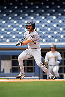 New Orleans Baby Cakes second baseman Steve Lombardozzi (4) follows through on a swing during a game against the Nashville Sounds on May 1, 2017 at First Tennessee Park in Nashville, Tennessee.  Nashville defeated New Orleans 6-4.  (Mike Janes/Four Seam Images)