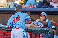 St. Louis Cardinals pitcher Carlos Martinez (18) is congratulated by manager Erick Almonte (44) after a rehab appearance during a Midwest League game between the Peoria Chiefs and the Bowling Green Hot Rods at Dozer Park on May 5, 2019 in Peoria, Illinois. Peoria defeated Bowling Green 11-3. (Zachary Lucy/Four Seam Images)