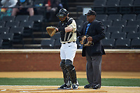 Wake Forest Demon Deacons catcher Brendan Tinsman (9) checks his wristband for the pitch call during the game against the Notre Dame Fighting Irish at David F. Couch Ballpark on March 10, 2019 in  Winston-Salem, North Carolina. The Demon Deacons defeated the Fighting Irish 7-4 in game one of a double-header.  (Brian Westerholt/Four Seam Images)