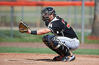 GCL Marlins catcher Matthew Foley (22) warms up the pitcher during the first game of a doubleheader against the GCL Mets on July 24, 2015 at the St. Lucie Sports Complex in St. Lucie, Florida.  GCL Marlins defeated the GCL Mets 5-4.  (Mike Janes/Four Seam Images)
