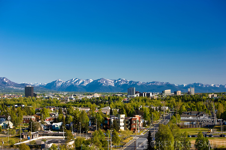 View of the midtown Anchorage, with the Kenai mountains in the background, spring foliage, Anchorage, Southcentral Alaska, USA.