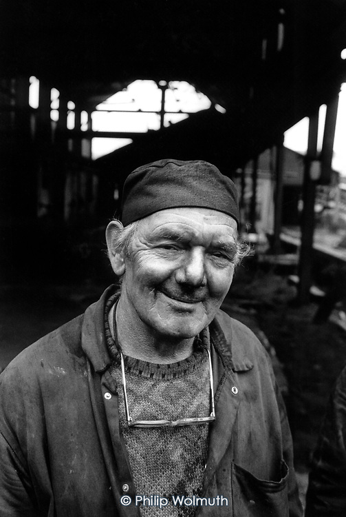 One of the last miners to go down Deep Navigation pit, in the village of Treharris, South Wales, on the day it closed.  The South Wales valleys used to employ 250,000 miners in 400 pits.