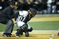 Wake Forest Demon Deacons catcher Christian Long (19) attempts to block a low pitch as home plate umpire Gregory Street looks on during the game against the Sacred Heart Pioneers at David F. Couch Ballpark on February 15, 2019 in  Winston-Salem, North Carolina.  The Demon Deacons defeated the Pioneers 14-1. (Brian Westerholt/Four Seam Images)