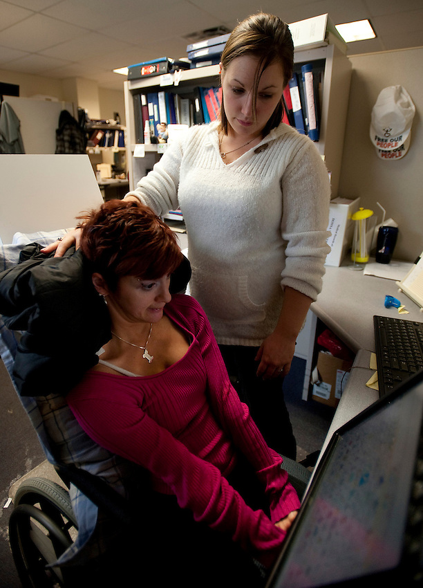 Healthcare advocate Kara Vander Veer and her personal assistant, Karisa Zuke at Arise, where Kara works to help people with disabilities obtain healthcare and make the transition to independant living. Photo by James R. Evans©