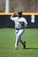 Tony Dibrell (17) of the Kennesaw State Owls warms up in the outfield prior to the game against the prior to the game against the Winthrop Eagles at the Winthrop Ballpark on March 15, 2015 in Rock Hill, South Carolina.  The Eagles defeated the Owls 11-4.  (Brian Westerholt/Four Seam Images)