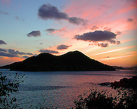 Beautiful sunset explodes behind the island