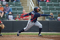 Braulio Vasquez (20) of the Rome Braves follows through on his swing against the Kannapolis Intimidators at Kannapolis Intimidators Stadium on April 7, 2019 in Kannapolis, North Carolina. The Intimidators defeated the Braves 2-1. (Brian Westerholt/Four Seam Images)