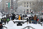 Many residents crowd Calle de Alcala next to the monument to the victims of Covid-19 during 'Filomena' snow storm in Madrid. January 9, 2021. (ALTERPHOTOS/Alejandro de Dios)