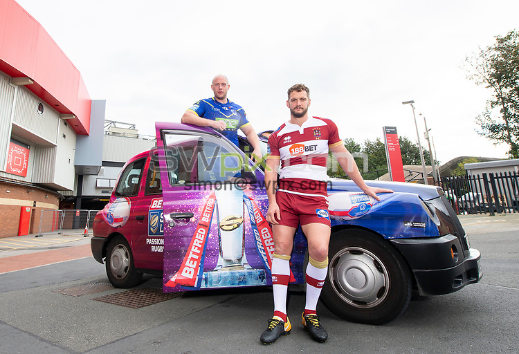 Picture by Allan McKenzie/SWpix.com - 08/10/2018 - Rugby League - Betfred Super League Grand Final Preview - Old Trafford, Manchester, England - Warrington's Chris Hill with Wigan's Sean O'Loughlin and the Betfred Super League taxi.