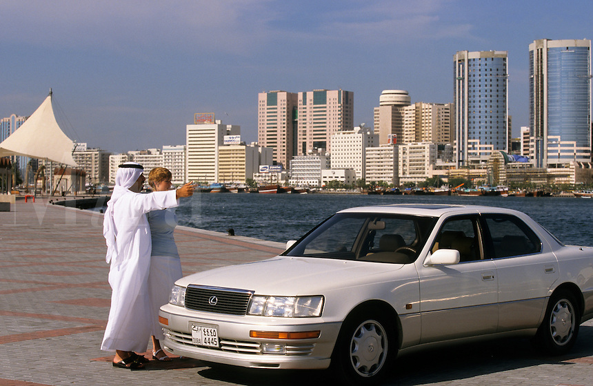 Dubai, United Arab Emirates. Dubai man showing the city to a European businesswoman..