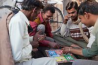 India, Rishikesh.  Men Playing Parcheesi.
