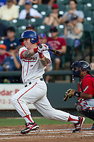 Wearing an Austin Senators throwback uniform, Round Rock Express outfielder Aaron Cunningham (3) follows through on his swing during the Pacific Coast League baseball game against the Oklahoma City RedHawks on July 9, 2013 at the Dell Diamond in Round Rock, Texas. Round Rock defeated Oklahoma City 11-8. (Andrew Woolley/Four Seam Images)
