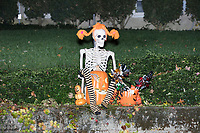 Life-sized skeletons are dressed up for Halloween decorations along Hillcrest Road in Belmont, Massachusetts, USA, on Mon., Oct. 30, 2017. A resident said the neighborhood has been doing similar coordinated decorations along the road for the previous 3 or 4 years. In this image, the skeleton appears to depict Pippi Longstocking.