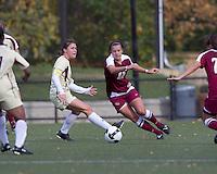 Boston College midfielder Julia Bouchelle (12) attempts to advance the ball as Boston College defender Hannah Cerrone (11) defends. Florida State University defeated Boston College, 1-0, at Newton Soccer Field, Newton, MA on October 31, 2010.