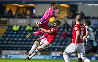Goalkeeper Matt Ingram of Wycombe Wanderers & Lee Barnard of Crawley Town collide during the Sky Bet League 2 match between Wycombe Wanderers and Crawley Town at Adams Park, High Wycombe, England on 28 December 2015. Photo by Andy Rowland / PRiME Media Images