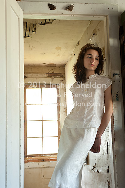 Young woman standing in doorway