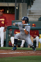 Adrian Damla (36) of the UC Irvine Anteaters bunts against the Southern California Trojans at Dedeaux Field on April 18, 2017 in Los Angeles, California. UC Irvine defeated Southern California, 14-3. (Larry Goren/Four Seam Images)