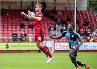 Matt Harrold of Crawley Town controls on the chest with Aaron Pierre of Wycombe Wanderers waiting behind during the Sky Bet League 2 match between Crawley Town and Wycombe Wanderers at Checkatrade.com Stadium, Crawley, England on 29 August 2015. Photo by Liam McAvoy.
