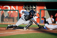 Burlington Bees catcher Keinner Pina (6) swipes the tag as Rafael Lantigua (9) slides in during a Midwest League game against the Lansing Lugnuts on July 18, 2019 at Cooley Law School Stadium in Lansing, Michigan.  Lansing defeated Burlington 5-4.  (Mike Janes/Four Seam Images)