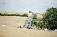 peloton moving through the french landscape<br /> <br /> 2014 Tour de France<br /> stage 4: Le Touquet-Paris-Plage/Lille Métropole (163km)