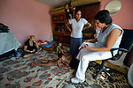 Ljatife Sikovska (right) is director of Ambrela, a grassroots Roma women's organization in Suto Orizari, the Macedonian municipality that is Europe's largest Roma settlement. Here she talks with a family in their home in Suto Orizari about their lack of sufficient legal documents, a common headache for Roma in Macedonia.