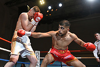 Mohammed Sameer (red shorts) defeats Kristaps Zulgis during a Boxing Show at the Corn Exchange on 25th September 2021