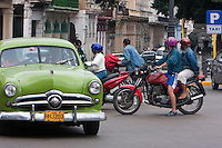 Cuba, Havana.  American Cars from the 1950s provide taxi service around Havana.  This is a 1949 or 1950 Ford.