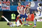 Atletico de Madrid's Gabi Fernandez (c) and Koke Resurrecccion (r) and Real Sociedad's Hector Hernandez during La Liga match. March 1,2016. (ALTERPHOTOS/Acero)
