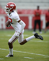 Arkansas receiver Jaedon Wilson runs with the ball Saturday, April 3, 2021, after making a catch during a scrimmage at Razorback Stadium in Fayetteville. Visit nwaonline.com/210404Daily/ for today's photo gallery. <br /> (NWA Democrat-Gazette/Andy Shupe)