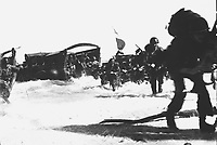 American troops of the 163rd Inf. Regt., hit the beach from Higgins boats during the invasion of Wadke Island, Dutch New Guinea.  May 18, 1944.  Lt. Kent Rooks.  (Army)<br /> NARA FILE #:  111-SC-190968<br /> WAR & CONFLICT BOOK #:  1173