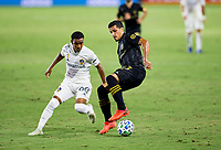 CARSON, CA - SEPTEMBER 06: Mohamed El-Munir #13 of LAFC turns with the ball during a game between Los Angeles FC and Los Angeles Galaxy at Dignity Health Sports Park on September 06, 2020 in Carson, California.