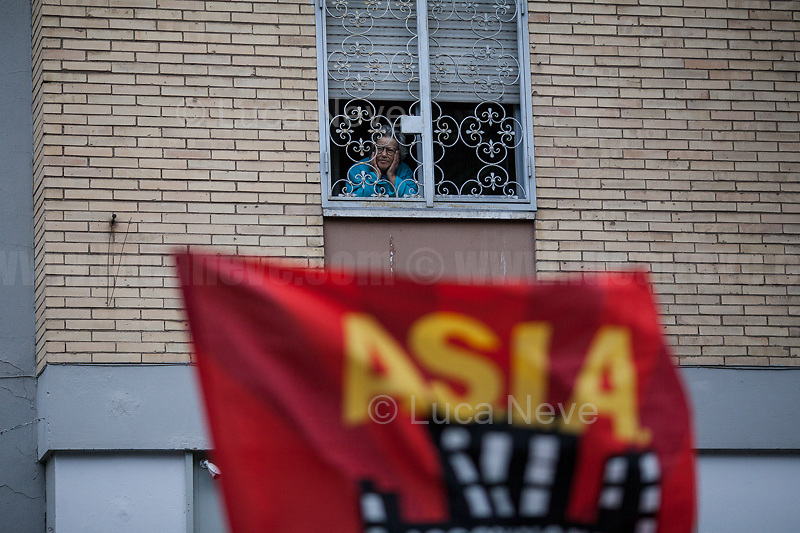 """Roma, 08/05/2019. Today, members of the far-right/neo-fascist political party 'casapound', held a rally in Casal Bruciato (suburb in the East side of Rome) in response to the allocation of a council flat to a Roma family - legally in the waiting list of Rome's Municipality - with twelve children and not any previous offenses committed. On the 7th of May a similar protest was held with the support of some residents of the district. Some members of the fascist organization 'casapound', undisputed by the police, insulted and menaced the Roma woman - while she was carrying her daughter in her arms - to """"rape"""" her, that she is a """"prostitute"""", and that all Roma people should be """"hanged"""".<br /> In the meantime, Anti-fascist / Anti-racist Organizations, Movements for Housing, social centres, members of the public, supported by trade unions and lefty political parties, held a counter-demonstration nearby. The demo was called to protest against the rally of """"casapound"""", accused to be a fascist group (illegal for the Italian Law so which needs to be immediately closed) - they call themselves """"fascists of the third millennium"""" - trying to fomenting hatred, pushing the people of the suburbs in a war between poor people, and to be just """"narrow-minded slander"""" ('sciacallaggio' in Italian).  <br /> The heavy police presence in full riot gears, supported by a water cannon truck and a helicopter, kept the two sides apart letting the Antifascist movements having a march in the district, once a historic """"Roccaforte Rossa"""" (a red stronghold)."""