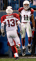Arizona Cardinals wide receiver Larry Fitzgerald (11) and Kurt Warner (13) celebrate a touchdown during the NFC Divisional Playoff football game at Bank of America Stadium, in Charlotte, NC. Arizona defeated the Carolina Panthers 33-13.