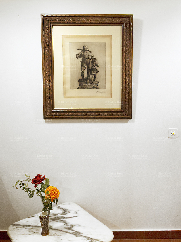 Switzerland. Canton Ticino. Biasca. On a cafe's wall, a painting of William Tell and his son. Willam Tell is carring his crossbow on the shoulder. Two roses in a vase. Marble table. William Tell (in the four languages of Switzerland: German: Wilhelm Tell; French: Guillaume Tell; Italian: Guglielmo Tell; Romansh: Guglielm Tell) is a folk hero of Switzerland. 27.12.12 © 2012 Didier Ruef