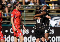 26 April 2009: Kandace Wilson of the FC Gold Pride celebrates with Tiffany Weimer of the FC Gold Pride after Wilson made an assist to Weimer's goal during the second half of the game against Washington Freedom at Buck Shaw Stadium in Santa Clara, California.   Washington Freedom defeated FC Gold Pride, 4-3.