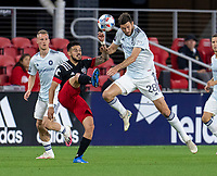 WASHINGTON, DC - MAY 13: Adrien Perez #16 of D.C. United fights for the ball with Elliot Collier #28 of Chicago Fire FC during a game between Chicago Fire FC and D.C. United at Audi FIeld on May 13, 2021 in Washington, DC.